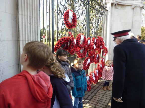 Young and old inspect the wreaths